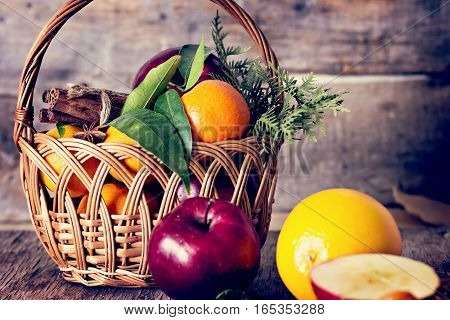 Apples, Oranges, Tangerines, Cinnamon In A Basket.