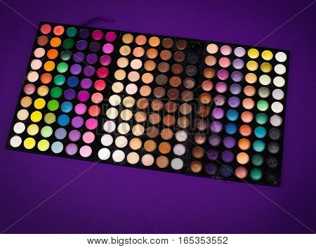 colorful eyeshadow palette in a blue background