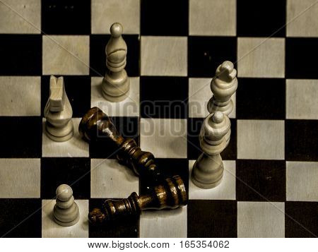 chess figures on the playing place, where black figures are leing