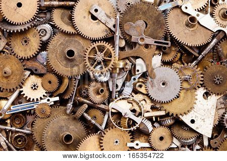 Aged gears cogwheels macro view. Steampunk mechanical equipment and mechanism background. Shabby grunge scratch metal texture. Shallow depth of field