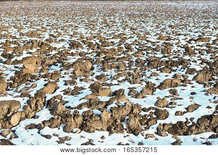 Melting Snow On Plowed Soil. Spring View Of Plowed Field.