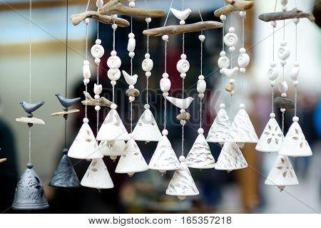 Cute White Ceramic Bells Sold On Easter Market In Vilnius, Lithuania