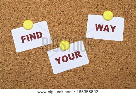Text Find Your Way on white stickers pinned on cork board