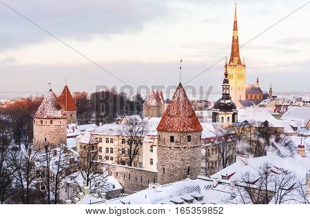 Panoramic view of the castle and the old town of Tallinn from the observation platform in winter poster
