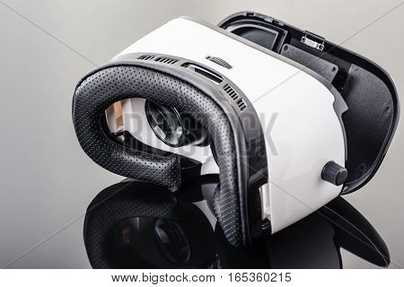 Virtual Reality Goggles On Black Surface