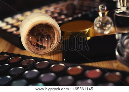 female cosmetic set. Eyeshadows with powder and perfume