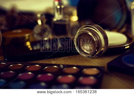 female cosmetic set, eye shadow with perfumes and powder