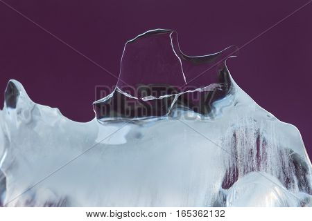 Abstract ice texture decorative background. Frozen violet crystal element. close up soft focus.