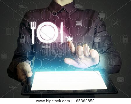 Image of a girl with tablet in her hands and food restaurant icon. She looking menus ordering food delivery rate restaurant with using online services.