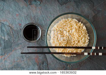 Soup Ramen noodles in glass bowl on tte blue background horizontal