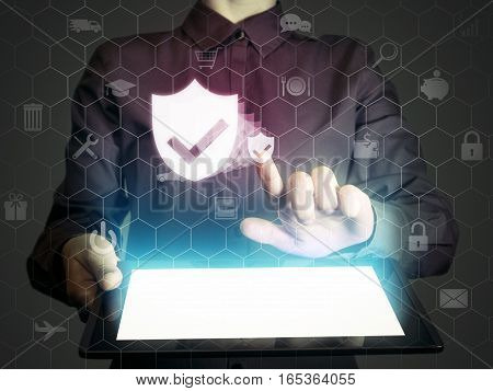 Image of a girl with a tablet in hands and shield icon. Data privacy online security protection concept.