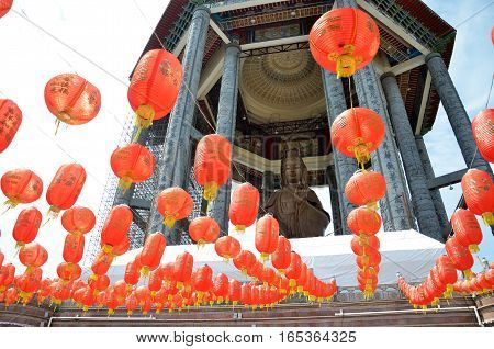 Guanyin and a red lanterns in Chinese Temple Penang Malaysia. Kek Lok Si Temple Place of worship near Georgetown.
