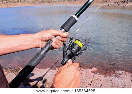 Fishing With Rod On Lake
