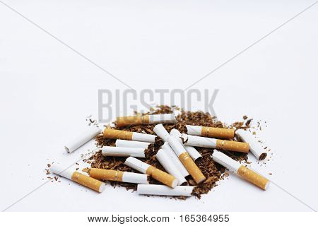 Brokern cigrettes and tobacco isolated on white background