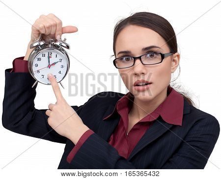 Shocked Businesswoman Pointing with Finger at Alarm Clock - Isolated