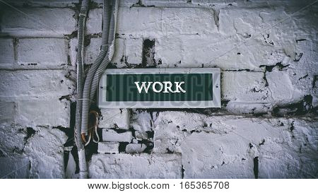 Brick Wall, White Words On A Green Background