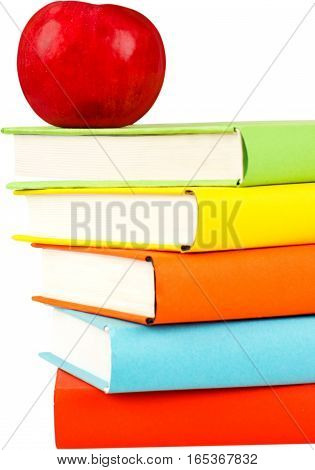 Textbooks with an apple on top - isolated image