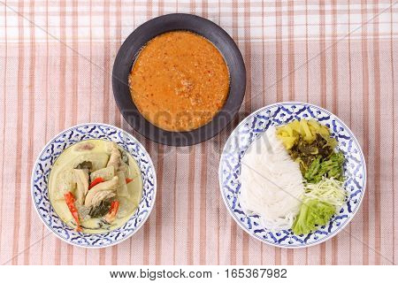 Rice Noodle , Green Chicken Curry And Fish Curry In Coconut-milk .