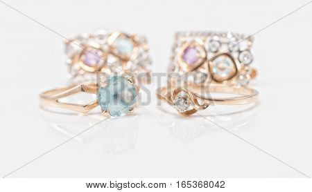 Two Gold Rings With Topaz And Diamond Set Of Earrings