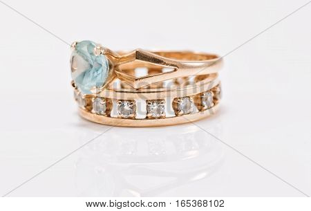 Gold Ring With Light Topaz And A Thick Ring With Diamonds