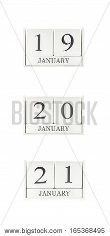 Closeup group of white wooden calendar with black 19 20 21 january word three date calendar isolated on white background