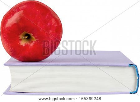 Textbook with an apple on top - isolated image