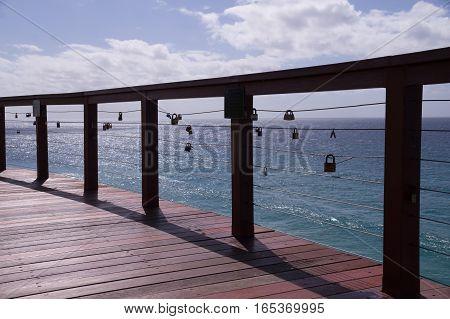 Love padlocks on handrail represent love and security