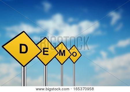 demo on yellow road sign with blurred sky background