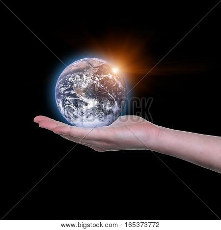 Earth in your hands Saving Earth concept Hands holding Earth with a black background. Elements of this image furnished by NASA