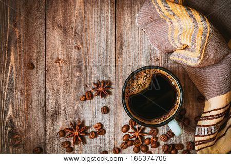 Cup of coffee on rustic wooden background. Top view.