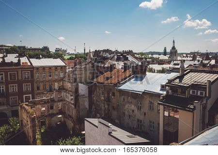 Blue sky and town buildings. Rooftops and urban ruins. Old district with rich history.