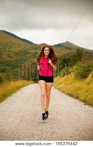 Runner - Woman Runns  On A Forest Road - Outdoor  Workout