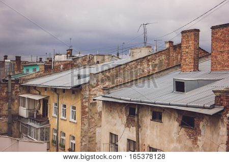 Old brick buildings. Rooftops and gloomy sky. Every street has its history.