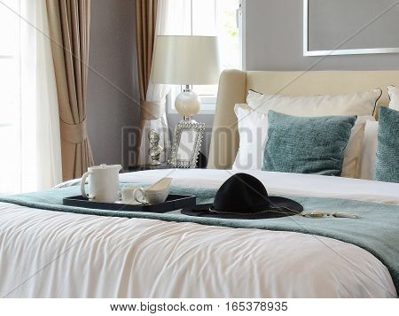 Black Tray Of Tea Set With White And Green Pillows In Classic Style Bedroom