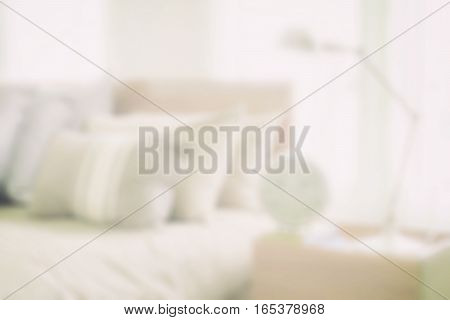Blurred Bedroom With Reading Lamp And Alarm Clock Next To Japanese Style Bedding