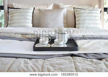 Decorative Tray With Black Tray Of Tea Set On The Bed In Modern Bedroom