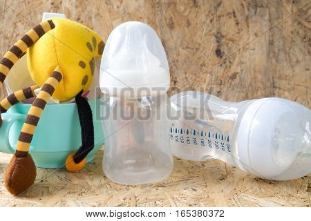 empty baby bottles with measurement markings in ml and oz