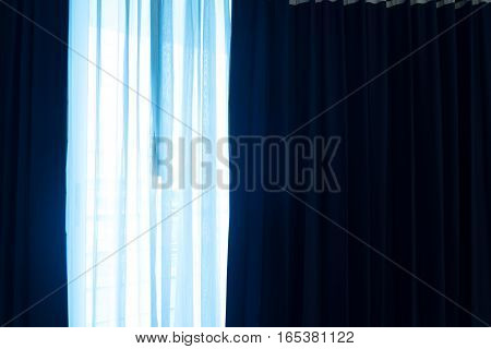 Close up light blue color curtain on the window