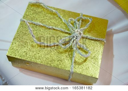 Christmas gift box gold glitter paper christmas abstract background