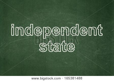 Political concept: text Independent State on Green chalkboard background