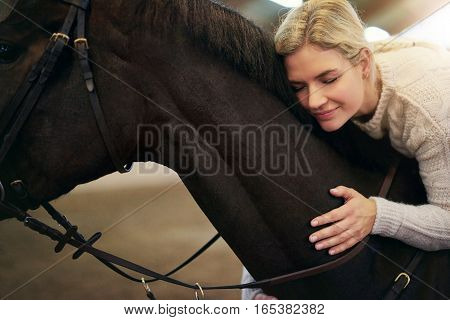 Female With Eyes Closed Hugging Dark Horse