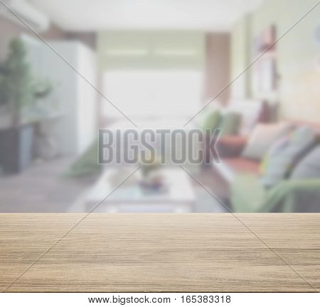 Wooden Table Top With Blur Of Colorful  Bedroom Interior As Background