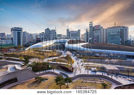 SEOUL SOUTH KOREA - MARCH 29 2015: Dongdaemun Design Plaza New development in Seoul designed by Zaha Hadid. Photo taken March 29 2015 in Seoul South Korea.