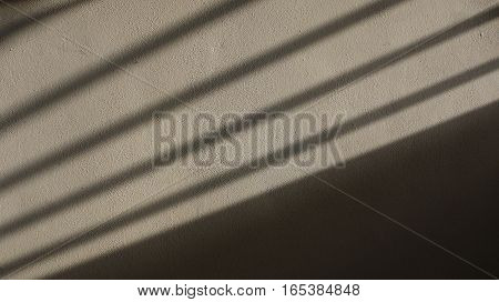Gate Shadow projected on a Concrete Wall