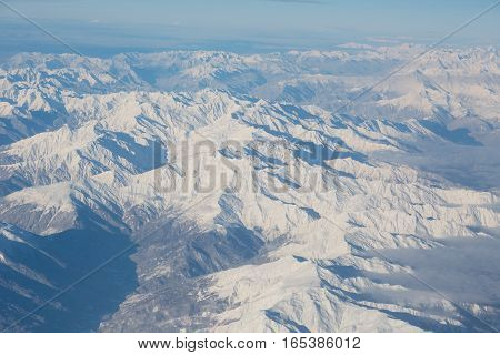 Snow-covered mountains of the Caucasus Mountains and Elbrus the view from the heights