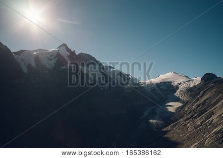 Grossglockner mountain and Pasterze glacier against sun Carinthia and East Tyrol Austria