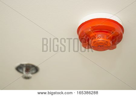 ceiling white fire detector used to activate warning systems in residential buildings select focus at fire detector