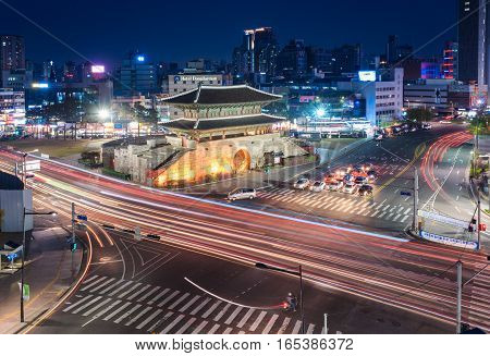 SEOUL - APRIL 11 2015: Dongdaemun Gate and Traffic April 11 2015 in Seoul Korea.