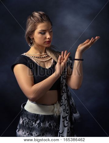 Dancing young woman in the national Indian costume