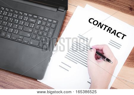 Business Insurance Lawyer Concept : Hand Using Pen Sign Business Contracts